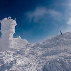 Photographer on ths summit of New Hampshire's Mount Washington in winter.