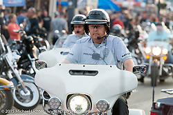Aberdeen, SD motor cops work Main Street in Sturgis during the 75th Annual Sturgis Black Hills Motorcycle Rally.  SD, USA.  August 3, 2015.  Photography ©2015 Michael Lichter.