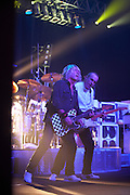 Rick Parfitt and Francis Rossi of rock band Status Quo play guitar riffs during gig on European tour in Lille, France. .