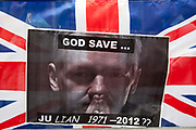 London, UK. Thursday 16th August 2012. Poster of Julian Assange on a Union Jack flag outside the Ecuador Embassy.