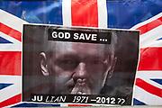 London, UK. Thursday 16th August 2012. Poster of Julian Assange on a Union Jack flag outside the Ecuador Embassy.