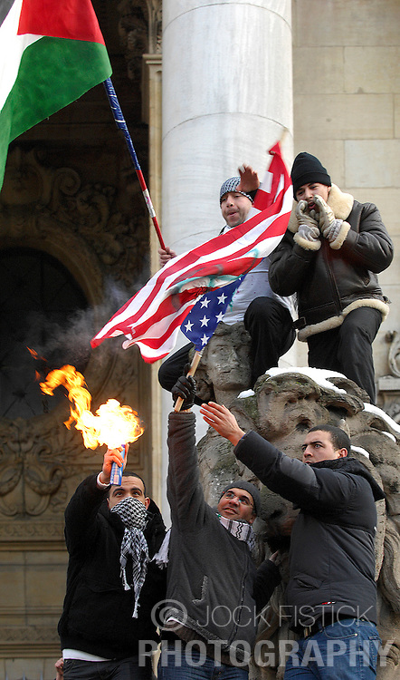 Protesters burn an American flag as thousands of people protest against the Israeli air strikes on Gaza, during a demonstration in Brussels, Belgium, Sunday, Jan. 11, 2009. (Photo © Jock Fistick)
