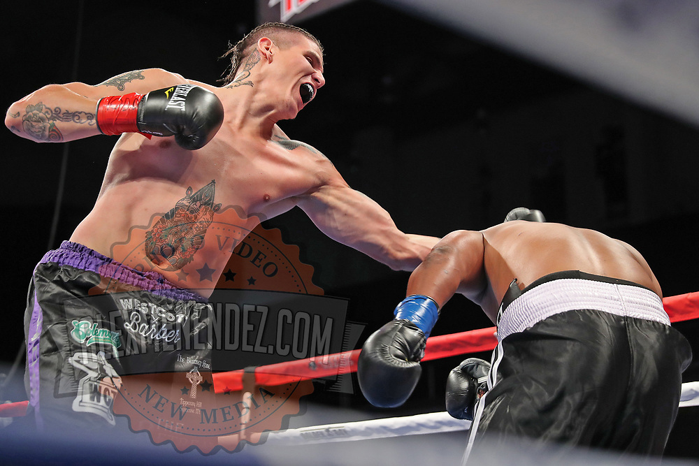 VERONA, NY - JUNE 08: Lawrence Gabriel punches Jimmy Levins during the Golden Boy on ESPN fight night at Turning Stone Resort Casino on June 8, 2018 in Verona, New York. (Photo by Alex Menendez/Getty Images) *** Local Caption *** Lawrence Gabriel; Jimmy Levins