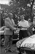16/09/1967<br /> 09/16/1967<br /> 16 September 1967<br /> Phoenix Park Motor Racing, Kingsway Trophy Race, sponsored by Player and Wills (Ireland) Limited. Image shows Mr T.W. Irvine (left) of Player Wills Ireland Ltd. presenting the Kingsway Trophy to Harold McGarrity, Savoy Motors, Belfast, winner of the Kingsway Trophy Race at the Phoenix Park.