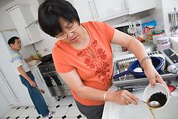 Woman making black bean sauce,