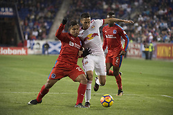 March 1, 2018 - Harrison, New Jersey, United States - Club Deportivo Olimpia Midfielder JAVIER PORTILLO (25) fights for the ball against New York Red Bulls midfielder SEAN DAVIS (27) during the CONCACAF Champions league match at Red Bull Arena in Harrison, NJ.  NY Red Bulls defeat CD Olimpia 2-0  (Credit Image: © Mark Smith via ZUMA Wire)