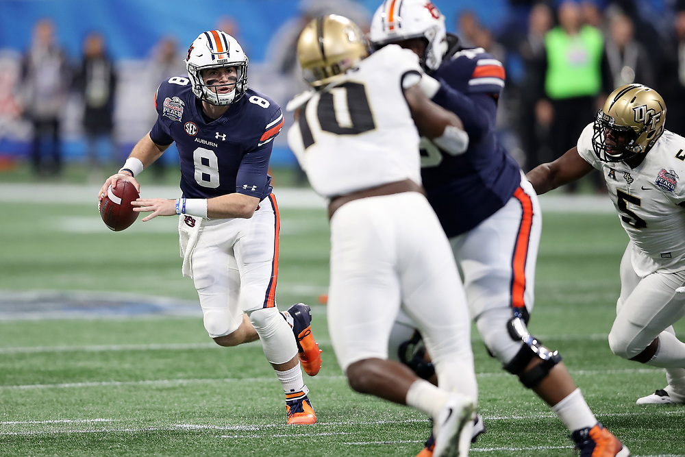 Auburn Tigers quarterback Jarrett Stidham (8) rolls out on a pass play during the 2018 Chick-fil-A Peach Bowl NCAA football game against the UCF Knights on Monday, January 1, 2018 in Atlanta. (Jason Parkhurst / Abell Images for the Chick-fil-A Peach Bowl)
