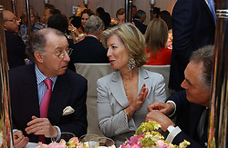 Left to right, The French ambassador to the UK GERARD ERRERA, MRS FORBES SINGER and LORD HINDLIP at the annual Chelsea Flower Show dinner hosted by jewellers Cartier at the Chelsea Pysic Garden, London on 22nd May 2006.<br /><br />NON EXCLUSIVE - WORLD RIGHTS