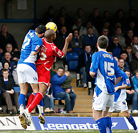 Sebastien Grimaldi of Chesterfield (left) beats Junior Agogo of Forest (right) in the air