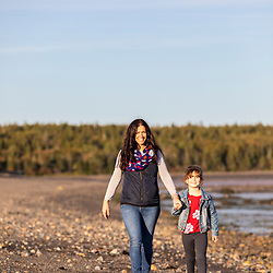 A woman and her daughter explore the Mowry Beach Preserve in Lubec, Maine.