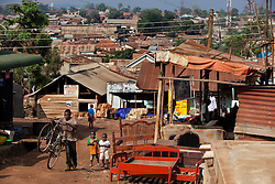 The neighborhood of Phiona Mutesi, a 14-year-old chess prodigy, in Kampala, Uganda,  Dec. 9, 2010. Mutesi days are spent in search of food, working at the market with her mother and dreaming of an escape from Katwe's slums. Although she is just now learning to read, her instincts have made her a player to watch in international chess. Mutesi, a naturally talented chess player is coached by Robert Katende of Sports Outreach Ministry. The chess club meets at the Agape Church inside Katwe, the largest of eight slums in Kampala.