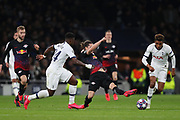 Defender Serge Aurier of Tottenham, Midfielder Marcel Sabitzer Of Leipzig and Midfielder Gedson Fernandes of Tottenham compete for the ball during the UEFA Champions League match between Tottenham Hotspur and RB Leipzig, at The Tottenham Hotspur Stadium, Thursday, Feb. 20 2020,  in  London, United Kingdom. (Mitchell Gunn/Image of Sport)