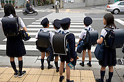 elementary school children waiting to cross the street Kyoto Japan