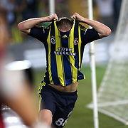 Fenerbahce's Caner Erkin celebrates his goal during their UEFA Europa League Group Stage Group C soccer match Fenerbahce between Marseille at Sukru Saracaoglu stadium in Istanbul Turkey on Thursday 20 September 2012. Photo by TURKPIX