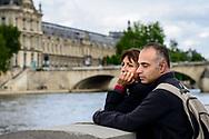 Couple on banks of Seine, Paris