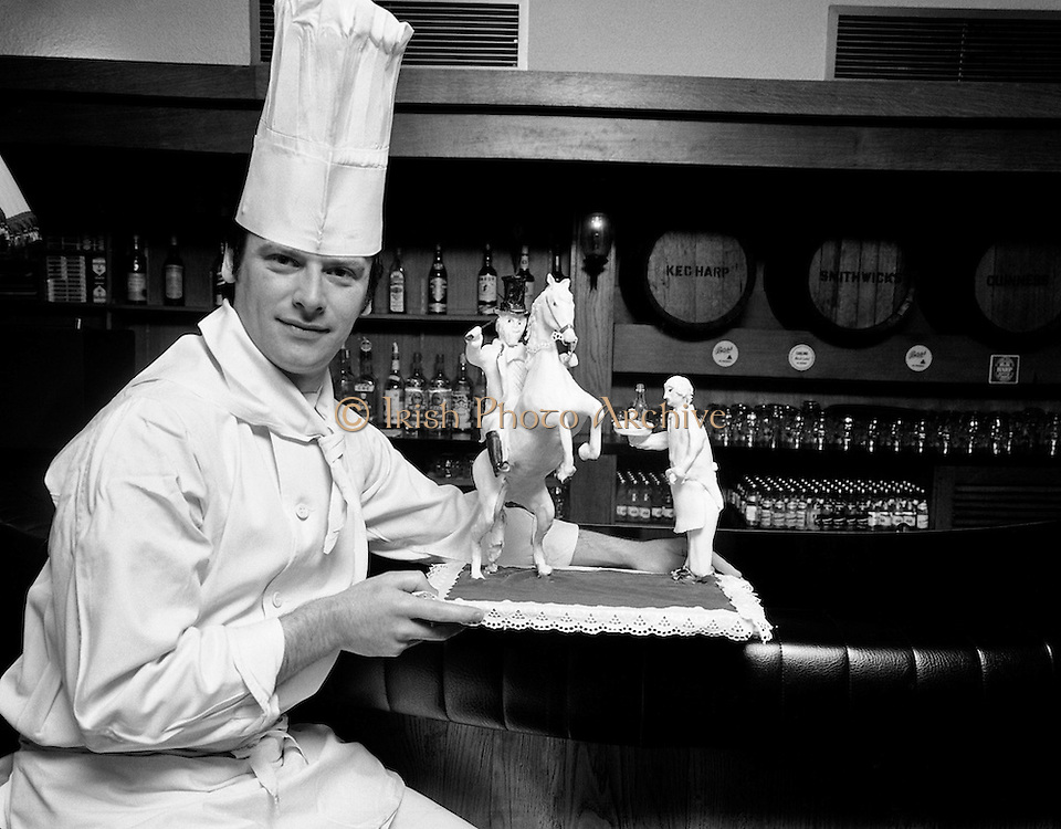 A chef from the Gresham Hotel, Dublin, with his butter sculpture of 'The Bird Flanagan'. Flanagan was a noted Dublin eccentric and prankster. He famously rode his horse in the doors of the Gresham Hotel and asked for a drink. 'It's after hours, sir', replied a porter. 'It's not for me, you fool, it's for the horse!' responded Flanagan.<br /> 07/06/1978