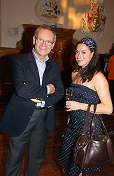 LORD ARCHER and KATIE NICHOLL at a party to celebrate the publication of Wicked - A Tale of Two Schools by Jilly Cooper held at Westminster School, Dean's Yard, London on 11th May 2006.<br /><br />NON EXCLUSIVE - WORLD RIGHTS