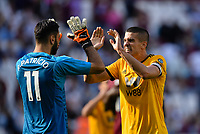 Football - 2018 / 2019 Premier League - West Ham United vs. Wolverhampton Wanderers<br /> <br /> Wolverhampton Wanderers' Conor Coady celebrates at the final whistle with Rui Patricio, at The London Stadium.<br /> <br /> COLORSPORT/ASHLEY WESTERN