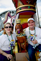 27 Jan 2013. New Orleans, Louisiana USA. .The Mystic Krewe of Barkus. King of the parade, Jaques the dog with owners Virginia Miller and Bruce Wallis. Following the theme 'Here Comes Honey Bow Wow,' the parade parodies a popular media title as dogs and their owners parade through the French Quarter in one of the most irreverent parades of the season..Photo; Charlie Varley