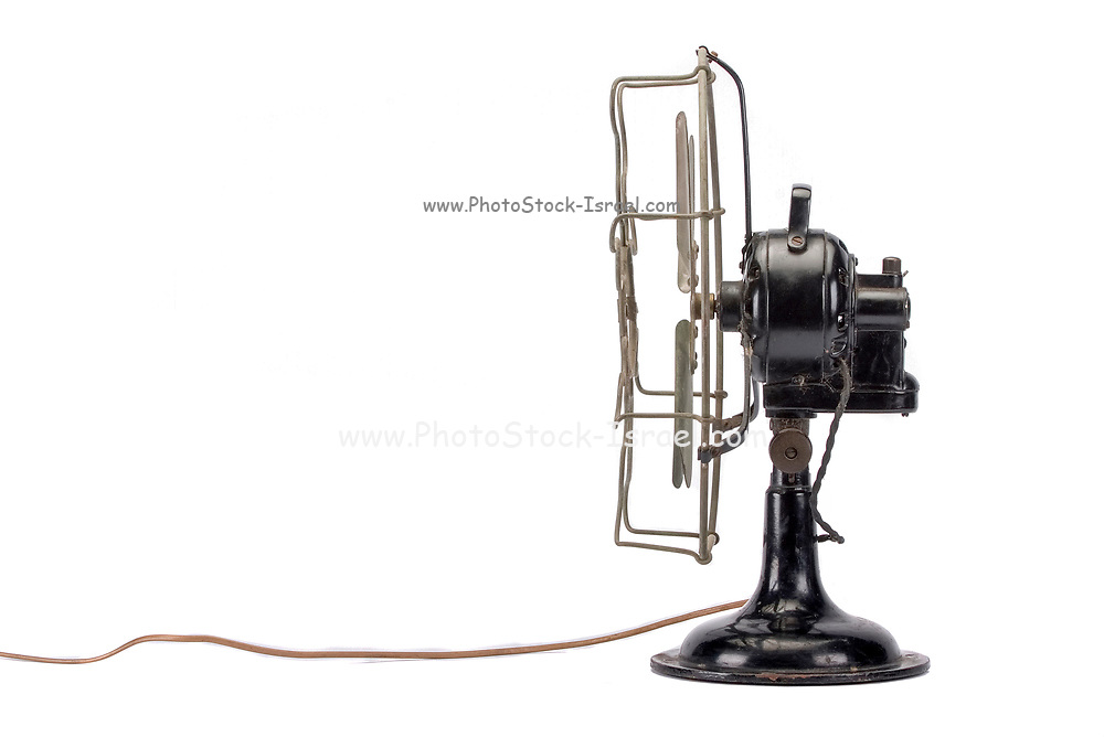 side view of a vintage fan on white background
