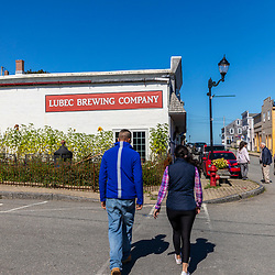 A couple walking in downtown Lubec, Maine.