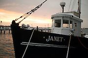 """USA, Newport, RI - Trap fighing boat """"Janet"""" weathers a winter snow at Bowen's Wharf."""