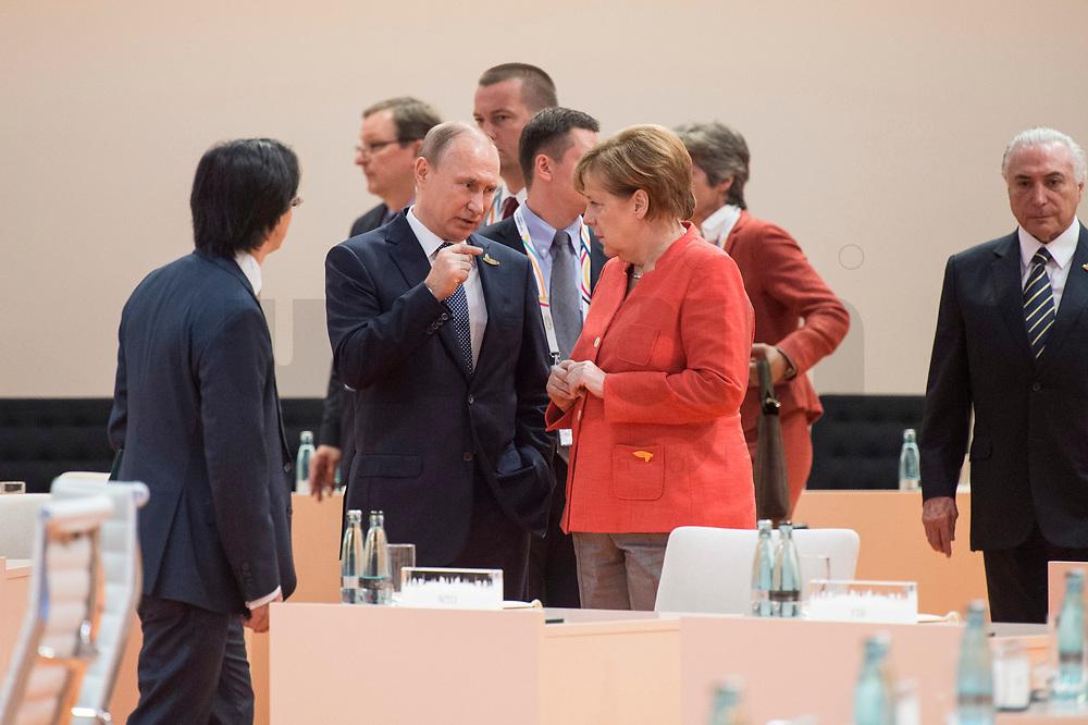 07 JUL 2017, HAMBURG/GERMANY:<br /> Vladimir Putin, Praesident Russische Foerderation, und Angela Merkel (R), CDU, Bundeskanzlerin, auf dem Weg durch den Sitzungssaal, 1. Arbeitssitzung, G20 Gipfel, Messe<br /> IMAGE: 20170707-01-007<br /> KEYWORDS: G20 Summit, Deutschland