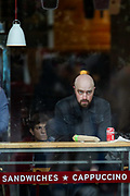 """A person is seen sitting at a """"Pret a Manger"""", a local chain of restaurants, not wearing a face protective surgical mask near Trafalgar Square in central London on Sunday, Aug 8, 2021. Scientists are warning the public not to be complacent, saying high levels of infection in the community are likely to lead to another spike in cases this fall. (VX Photo/ Vudi Xhymshiti)"""
