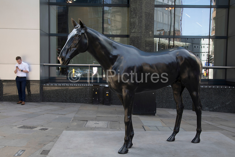 Sculpture in the City on July 17th 2017 in the City of London, England, United Kingdom. Each year, the critically acclaimed Sculpture in the City returns to the Square Mile with contemporary art works from internationally renowned artists in a public exhibition of artworks  open to everyone to come and interact with and enjoy. The Black Horse by Mark Wallinger 2015