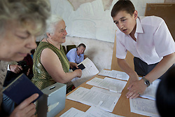 Mykola Glotov, an attorney, helps Ljudmila Datsjuk during a Òspecial consultationÓ for potential clients who are children of the Second World War, Rivne, Ukraine, June 15, 2011. This vulnerable group is made up of seniors, most of whom are not receiving proper compensation as promised by the government. The legal team advises them on how to properly fill out forms and submit them to the courthouse, while encouraging them not to give up on their rights. More than half of the worldÕs population, four billion people, live outside the rule of law, with no effective title to property, access to courts or redress for official abuse. The Open Society Justice Initiative is involved in building capacity and developing pilot programs through the use of community-based advocates and paralegals in Sierra Leone, Ukraine and Indonesia. The pilot programs, which combine education with grassroots tools to provide concrete solutions to instances of injustice, help give poor people some measure of control over their lives.