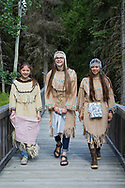 The K'Beq' Interpretive Site. The Sovereign Nation of The Kenaitze <br /> <br /> From left to right are Emilee Wilson (age 13), Denali Bernard (age 15) and Julianne Wilson (age 20)<br /> <br /> All three live in Kenai and they have been involved in the Kenaitze Indian Tribe's Yaghanen Youth Programs since they were in 1st grade.  They have participated in Yaghanen's Native Youth Olympics team, Jabila'ina Dance group, Del Dumi drum group and summer culture camps.  Denali states that she enjoys being involved in the programs because they are fun and she gets to meet new friends. <br /> <br /> The dresses would have been traditionally made with caribou skins but the ones that the girls are wearing in the photo are replicas made from pig skin.  The fur around the neck is sea otter.  The dance group was given its' name by one of our Kenaitze Elders that has long passed.  The name Jabila'ina means People of the Rainbow and is to signify that our group is made up from youth from all cultural backgrounds.  Because of this we allow our youth to wear head dresses from their individual cultures if they wish.  The Wilson girls are Dena'ina Athabaskan and Denali is of Inupiaq descent.  The head dresses that they are wearing have traditionally within our dance group, signified that a girl has made the transition into womanhood.  The cloths that they are holding are used only when dancing and only by the women. <br /> <br /> Photographer: Christina Sjögren<br /> <br /> Copyright 2019, All Rights Reserved