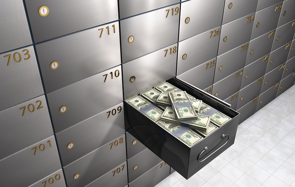 3D rendering a bank safety deposit box full of money.