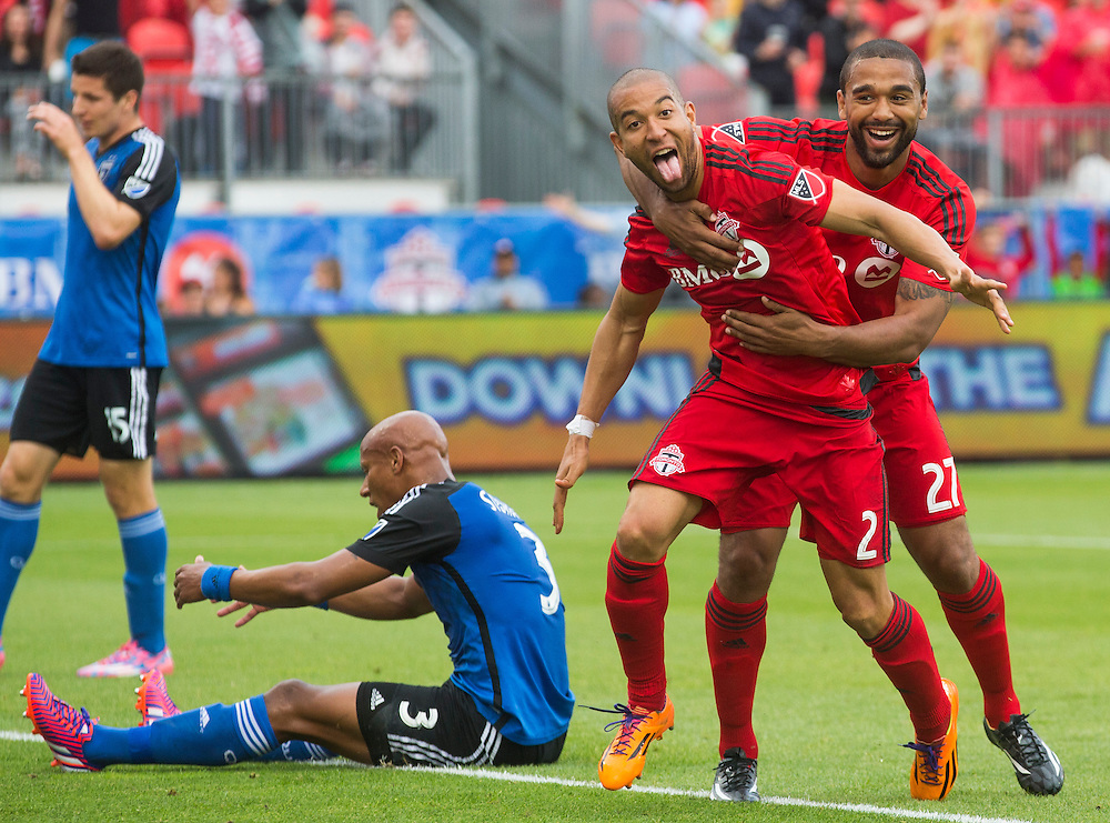 Toronto FC Justin Morrow celebrates his goal with Luke Moore, right, against the San Jose Earthquakes Jordan Stewart, left, during the first half of MLS soccer action in Toronto, Saturday May 30, 2015.    THE CANADIAN PRESS/Mark Blinch