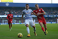 Eduardo Vargas of Queens Park Rangers holding the ball from Paul Konchesky of Leicester City.  Barclays Premier league match, Queens Park Rangers v Leicester city at Loftus Road in London on Saturday 29th November 2014.<br /> pic by John Patrick Fletcher, Andrew Orchard sports photography.