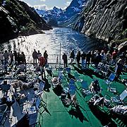 Three weeks aboard the Kong Harald. Hurtigruten, the Coastal Express. People in the Trollfjord.
