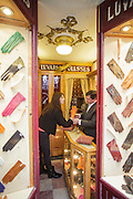 A lady tests gloves at the Luvaria Ulisses, a traditional shop in Chiado district, founded in 1925 that maintains intact the same decoration.