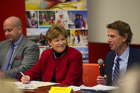 Justin Slattery Belknap EDC and Senator Jeanne Shaheen listen as Dr. Ross Gittell Chancellor of the Community College System addresses the audience during the Lakes Region Workforce Development Resource Summit on Friday morning.  (Karen Bobotas/for the Laconia Daily Sun)