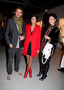STAVROS NIARCHOS; GIOVANNA BATTAGLIA; SARA BATTAGLIA, Private view of the exhibition ' Mother of Pouacrus' by Nicholas Pol. Presented by Vladimir Restoin Roitfeld. The Old Dairy, Wakefield St.  London. 14 October 2010. <br /> <br /> -DO NOT ARCHIVE-© Copyright Photograph by Dafydd Jones. 248 Clapham Rd. London SW9 0PZ. Tel 0207 820 0771. www.dafjones.com.