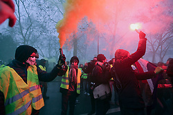 19 January 2019. Paris, France.<br /> Gilets Jaunes - Acte X take to the streets of Paris. Young men light flares at the end of the demonstration just before trouble sets in. An estimated 7,000 people took part in the looping 14 km route from Place des Invalides to protest tax hikes from the Government of Emmanuel Macron imposed on the people. An estimated 80,000 people took part in protests across the country. Regrettably the movement has attracted a violent element of agitators who often face off with riot police at the end of the marches which tends to deflect attention away from the message of the vast majority of peaceful protesters.<br /> Photo©; Charlie Varley/varleypix.com