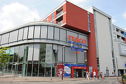 © London News Pictures. 14/07/2013. COPY AVAILABLE BELOW…. TESCO Extra in Orpington, Kent, which has been blamed for the downturn of the local high street. . Orpington High street now has 12 charity shops  in one short stretch, with Cancer Research UK having two shops on different sides of the high street almost facing each other.  COPY AVAILABLE HERE:  http://tinyurl.com/nhtxtyd<br /> <br /> Photo credit :Grant Falvey/LNP