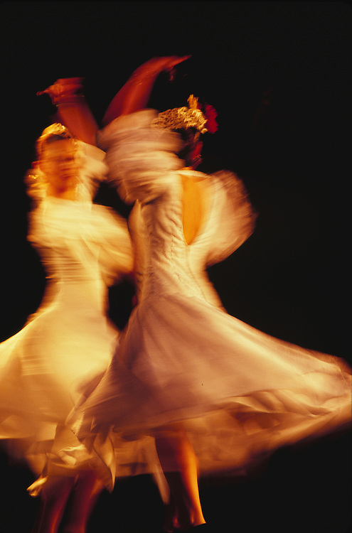 Europe, Spain, Andalucia, Sevilla, two female flamenco dancers at night (blurred motion)