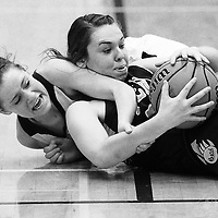 ORIG 01/7/2015 Ryan Brennecke / The Bulletin<br /> Ridgeview's Shaelia Wilcox (12) attempts to steal the ball from Bend's  Allison Parker during the first half in Redmond on Friday.