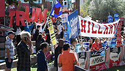 Oct 19, 2016. Las Vegas NV.  Clinton and Trump supporters rally together at UNLV hours before the debate Wednesday. Today will be the 3rd and final presidential debate between Republican presidential nominee Donald Trump and Democratic presidential nominee Hillary Clinton at Las Vegas Nevada University. .Photo by Gene BlevinsZumaPress (Credit Image: © Gene Blevins via ZUMA Wire)