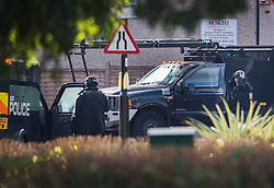 © Licensed to London News Pictures. 22/10/2016. London, UK. Armed police are seen in Northolt. Police attended an address in Wood End Lane, Northolt at shortly after 00:50hrs on Friday, 21 October after a report of concerns for the occupant and hazardous items inside the property. Police believe a man is still inside the house. Photo credit: Ben Cawthra/LNP
