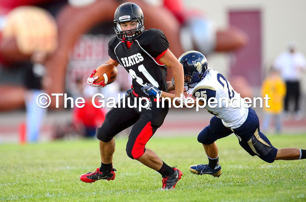 083013  Adron Gardner/Independent<br /> <br /> Grants Pirate Rosendo Jaramillo (21) drags Santa Fe Demon Christian Gonzalez (25) at Grants High School Friday.