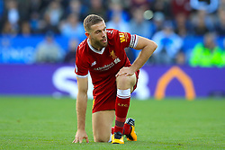 Liverpool's Jordan Henderson reacts after a fowl during the Premier League match at King Power Stadium, Leicester.