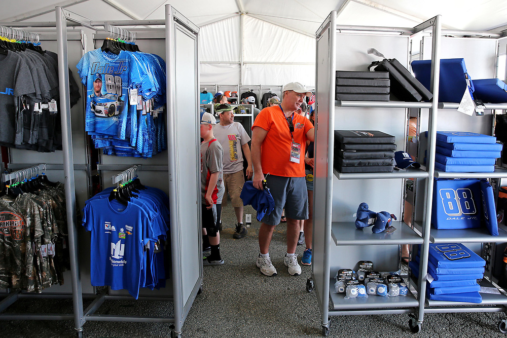 Apr 30, 2017; Richmond, VA, USA; Glenn Marx of Long Island, NY looks at merchandise for NASCAR Cup Series driver Dale Earnhardt Jr. (88) before the Toyota Owners 400 at Richmond International Raceway. Mandatory Credit: Peter Casey-USA TODAY Sports