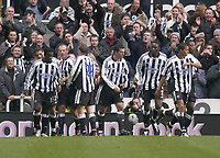 Photo. Glyn Thomas.<br /> Newcastle United v Aston Villa. Barclaycard Premiership.<br /> St James' Park, Newcastle. 01/11/03.<br /> Newcastle's Laurent Robert (L) is congratulated by teammates after scoring his side's equliser just seconds before half time.