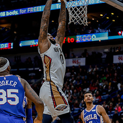 Dec 10, 2017; New Orleans, LA, USA; New Orleans Pelicans center DeMarcus Cousins (0) dunks over Philadelphia 76ers forward Trevor Booker (35) and guard Timothe Luwawu-Cabarrot (7) during the second quarter of a game at the Smoothie King Center. Mandatory Credit: Derick E. Hingle-USA TODAY Sports