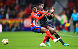 Arsenal's Danny Welbeck (right) and Atletico Madrid's Partey Thomas battle for the ball during the UEFA Europa League, Semi Final, Second Leg at Wanda Metropolitano, Madrid.
